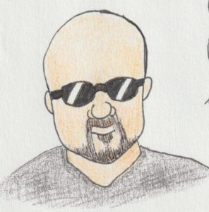 Sporting a goatee as pretty much the only hair on his head, Marc is also wearing his shades.